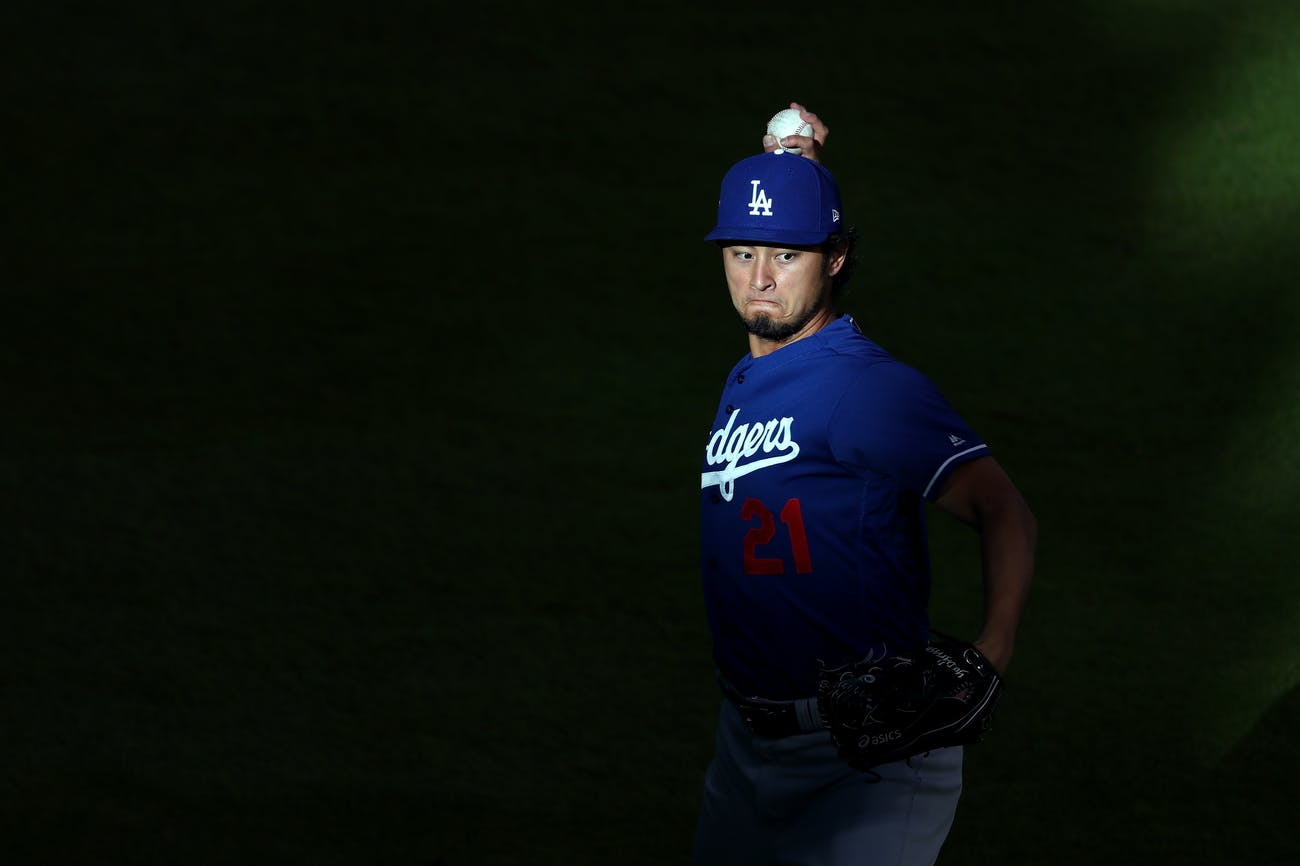 HOUSTON, TX - OCTOBER 29: Yu Darvish #21 of the Los Angeles Dodgers warms up before game five of the 2017 World Series against the Houston Astros at Minute Maid Park on October 29, 2017 in Houston, Texas. (Photo by Tom Pennington/Getty Images)