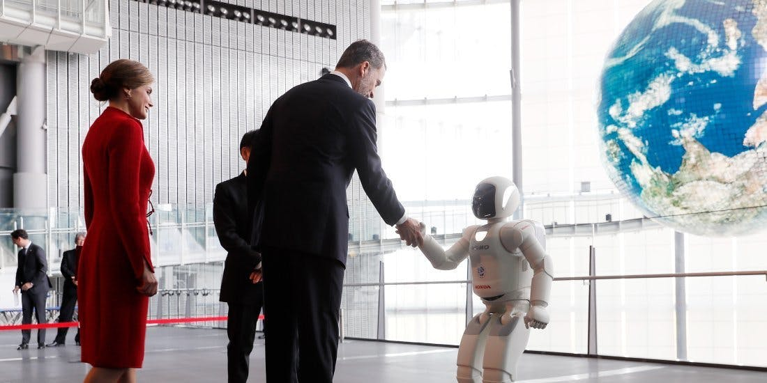 King Felipe VI shakes hands with an ASIMO robot during their visit to the National Museum of Emerging Science and Innovation (Miraikan) on April 5, 2017 in Tokyo, Japan.