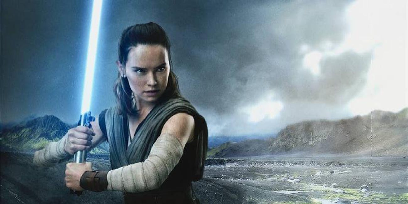 Rey (Daisy Ridley) wields Luke Skywalker's old blue lightsaber in 'The Last Jedi'.