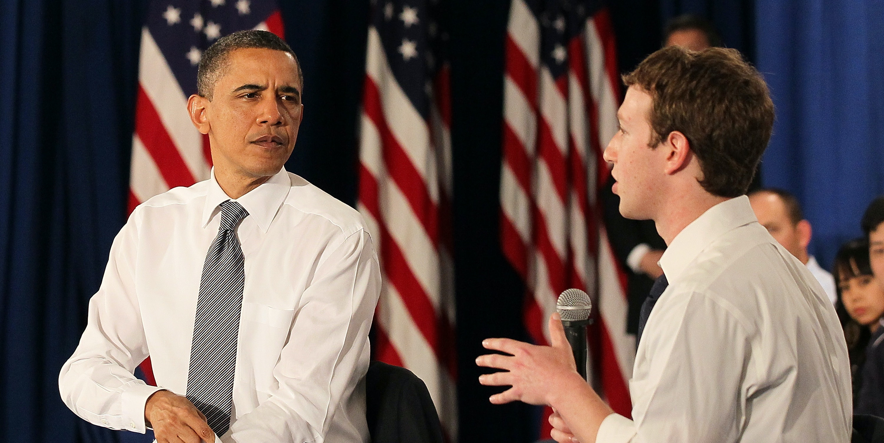 President Barack Obama talks with Facebook CEO Mark Zuckerberg during a town hall style meeting at Facebook headquarters on April 20, 2011, in Palo Alto, California. Obama held the Facebook town hall to answer questions about the deficit and the economy.