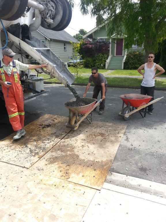 Permeable concrete pours from a mixer.