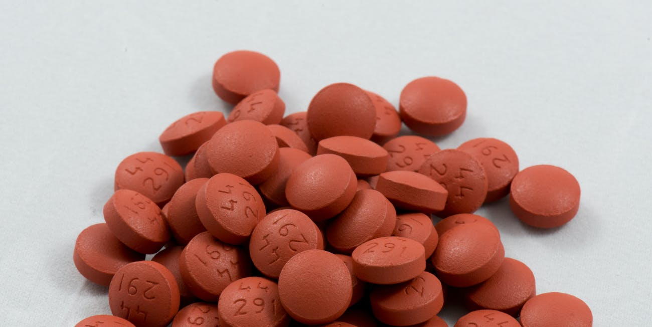 Pile of Ibuprofen tablets