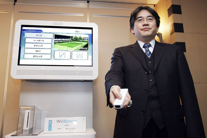 TOKYO - DECEMBER 7: Nintendo president Satoru Iwata presents the Wii game console during a press conference on December 7, 2006 in Tokyo, Japan. Wii will go on sale on December 8 in Europe. (Photo by Junko Kimura/Getty Images)