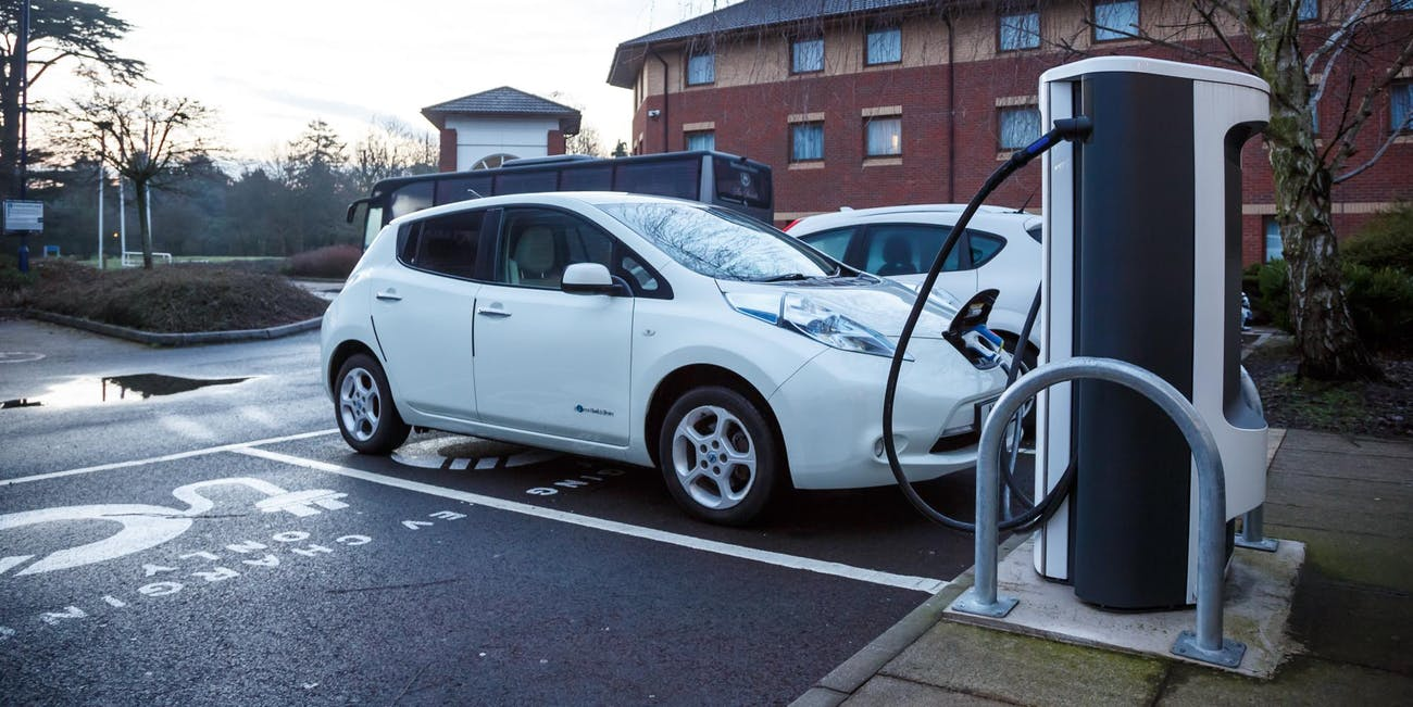 Electric car charging in public. Rapid charger. Nissan Leaf. Polar Free Car Picture - Give Credit Via Link