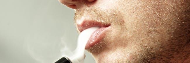E Cigarette User Exhaling Vapor Smoke - Vape Pen e cig Device