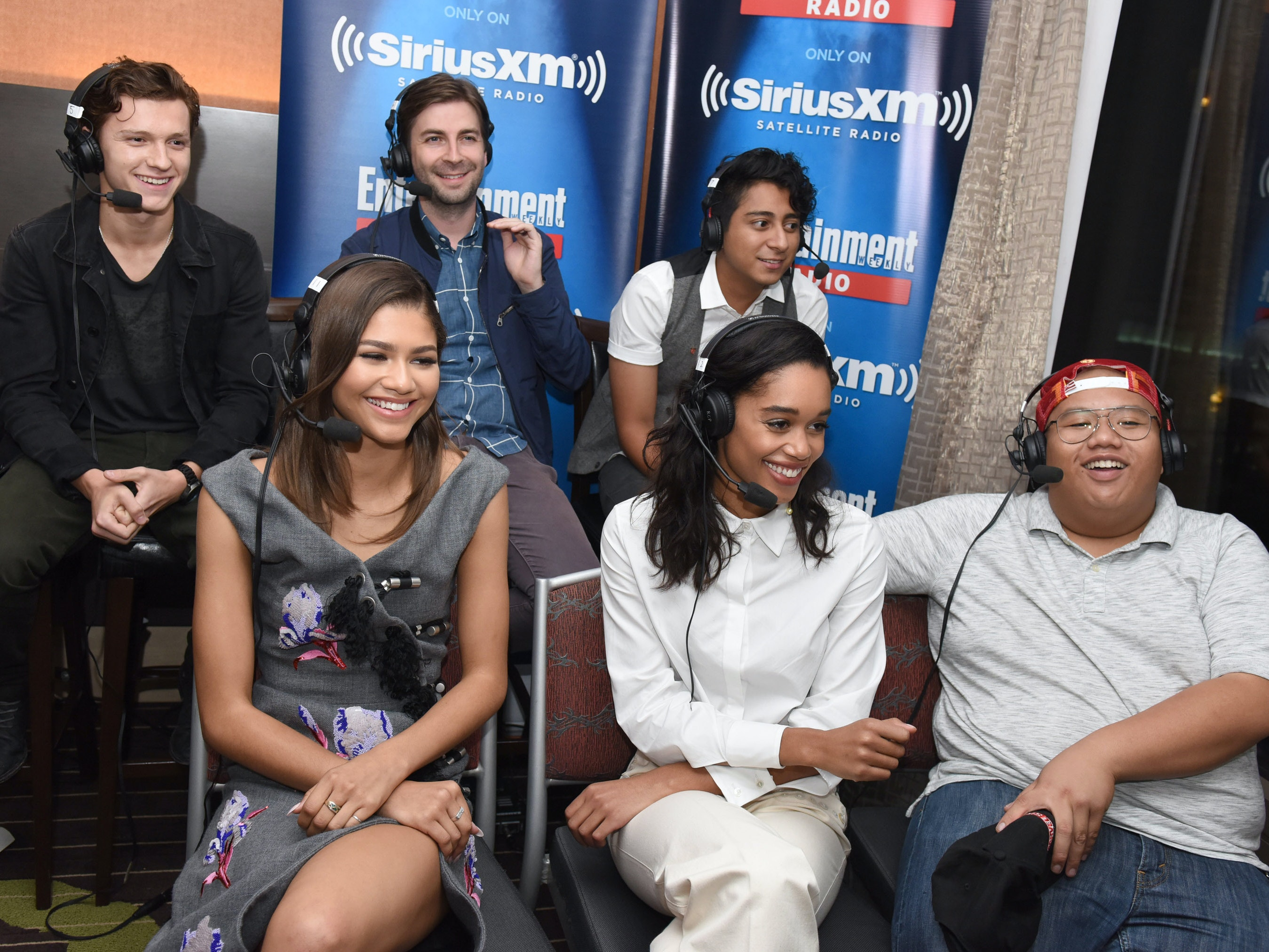 SAN DIEGO, CA - JULY 23:  Actor Tom Holland, director Jon Watts and actors Tony Revolori, Zendaya Coleman, Laura Harrier and Jacob Batalon attend SiriusXM's Entertainment Weekly Radio Channel Broadcasts From Comic-Con 2016 at Hard Rock Hotel San Diego on July 23, 2016 in San Diego, California.  (Photo by Vivien Killilea/Getty Images for SiriusXM)