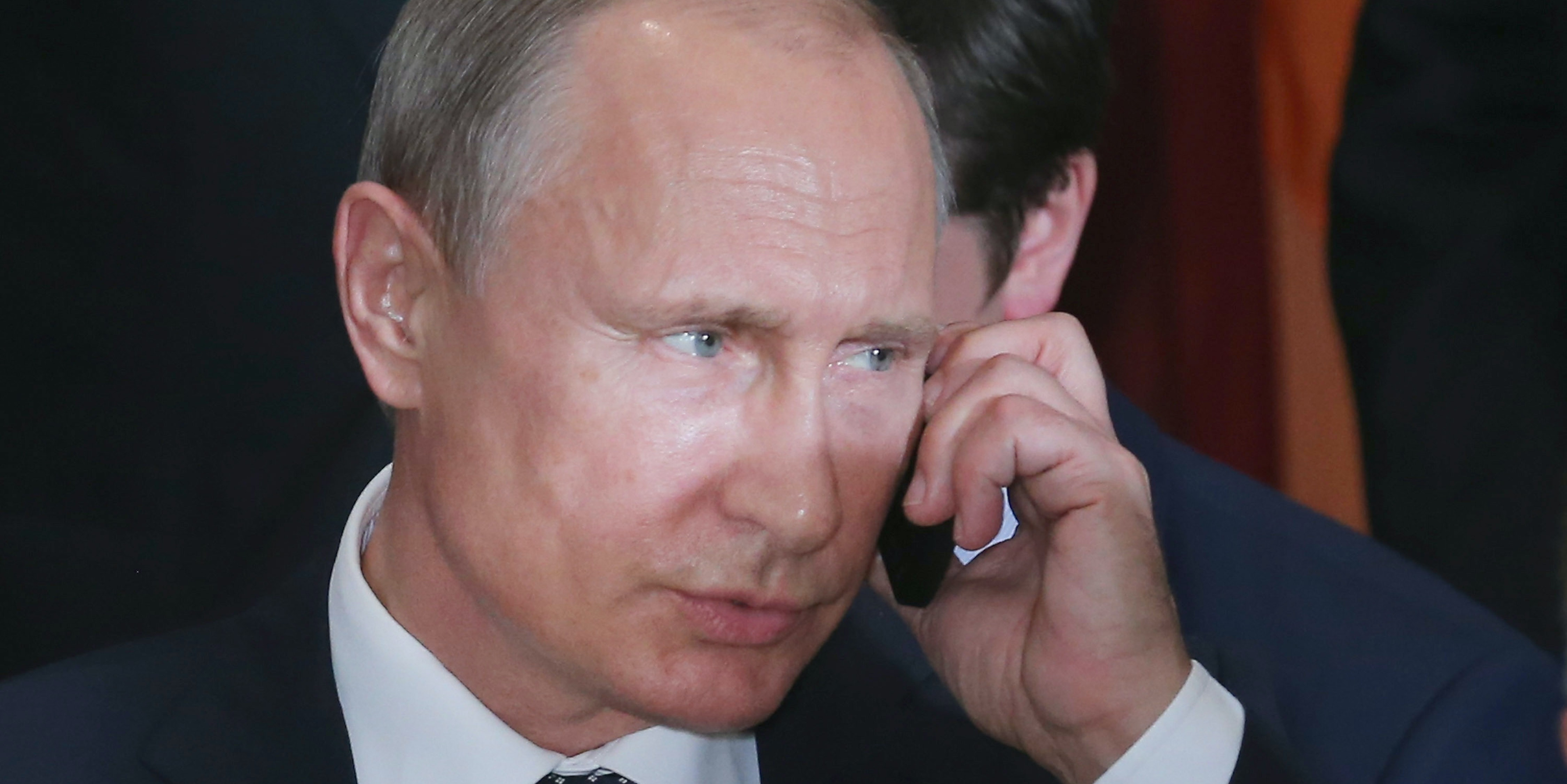 Russian President Vladimir Putin takes a call during a luncheon hosted by United Nations Secretary-General Ban Ki-moon at the 70th annual UN General Assembly at the UN headquarters September 28, 2015 in New York City.
