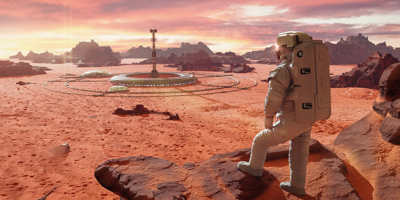 Astronaut looking at Mars colony