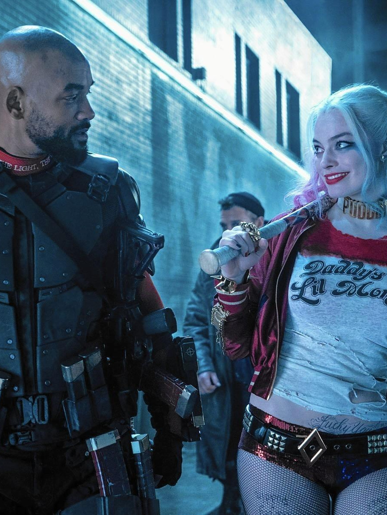 Will Smith as Deadshot and Margot Robbie as Harley Quinn in DC's Suicide Squad