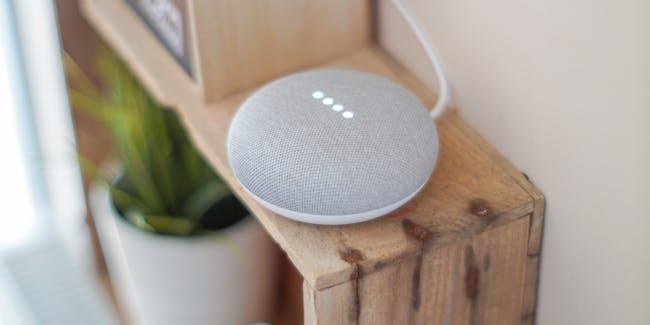 Round Grey Speaker On Brown Board · Free Stock Photo