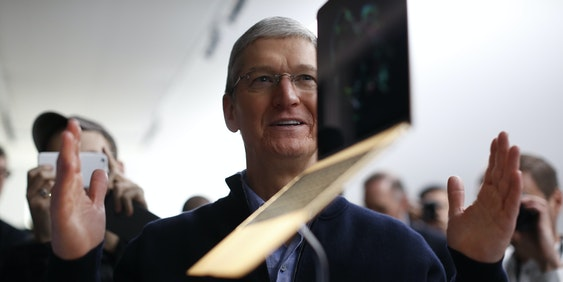 SAN FRANCISCO, CA - MARCH 9: Apple CEO Tim Cook stands in front of an MacBook on display after an Apple special event at the Yerba Buena Center for the Arts on March 9, 2015 in San Francisco, California. Apple Inc. announced the new MacBook as well as more details on the much anticipated Apple Watch, the tech giant's entry into the rapidly growing wearable technology segment as well (Photo by Stephen Lam/Getty Images)