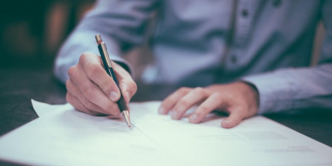 Attorney writing documents with a pen