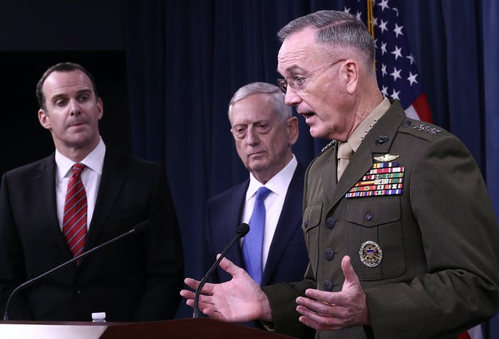 ARLINGTON, VA - MAY 19: Chairman of the Joint Chiefs of Staff Marine Gen. Joseph F. Dunford Jr (R), U.S. Secretary of Defense Jim Mattis (C) and Special Presidential Envoy for the Global Coalition to Counter ISIS Brett McGurk (L) answer questions during a Pentagon briefing May 19, 2017 in Arlington, Virginia. Mattis, Dunford, and McGurk briefed members of the press on the status of U.S. President Donald Trump's campaign to defeat ISIS. (Photo by Win McNamee/Getty Images)
