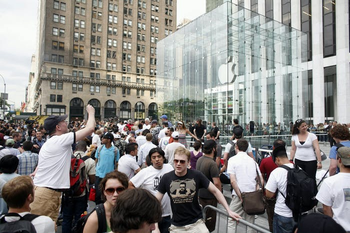 People wait for iPhones in 2007.