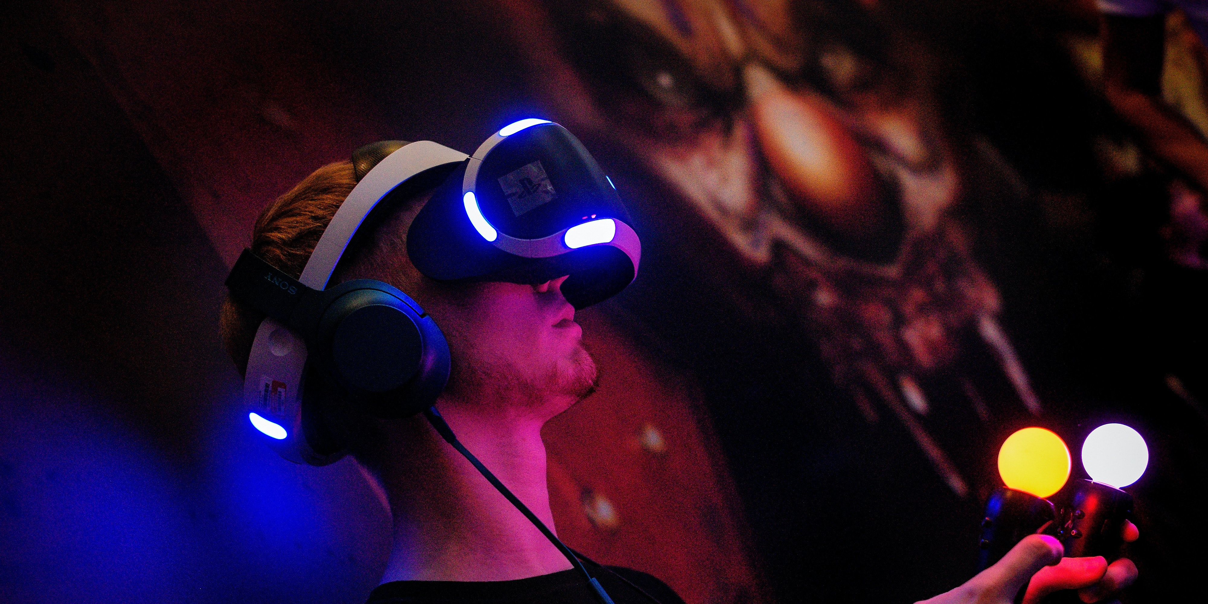 GERMANY - AUGUST 17: A Visitor try out a VR game at the Sony Play Station stand at the Gamescom 2016 gaming trade fair during the media day on August 17, 2016 in Cologne, Germany. Gamescom is the world's largest digital gaming trade fair and will be open to the public from August 18-21. (Photo by Sascha Schuermann/Getty Images)
