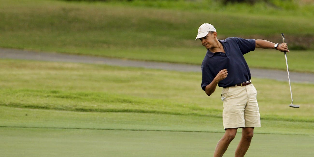 Barack Obama golf pose left hand putt putter