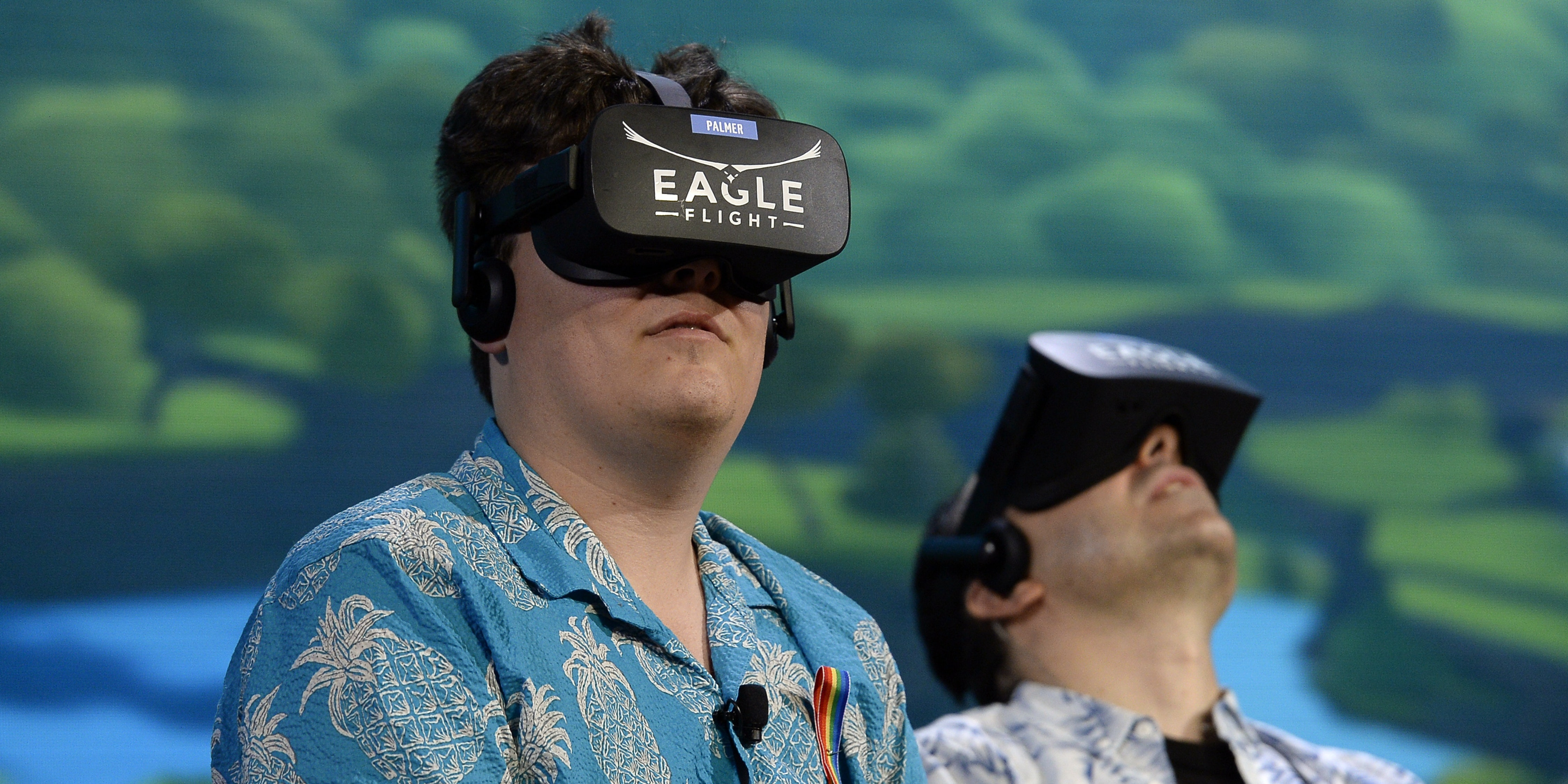Palmer Luckey, co-founder of Oculus VR Inc., left, plays the new video game 'Eagle Flight VR' during an Ubisoft news conference before the start of the E3 Gaming Conference on June 13, 2016 in Los Angeles, California.