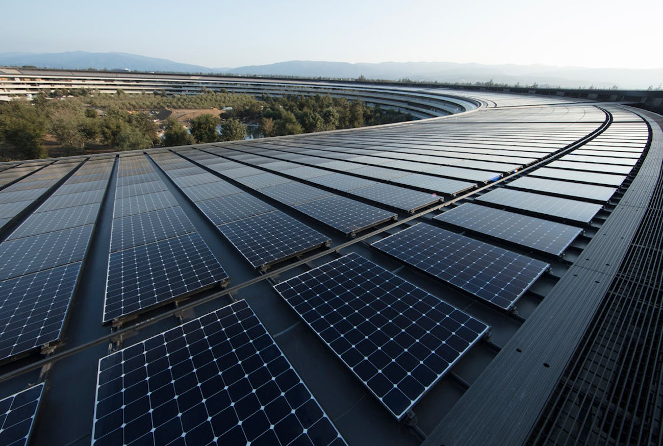 Apple's solar panels on top of the spaceship campus provide green energy.