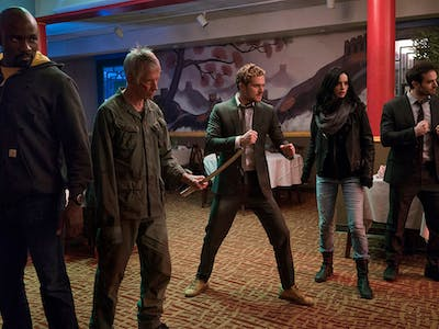 Could it be the 5 members of the Defenders vs. the 5 fingers of the Hand?