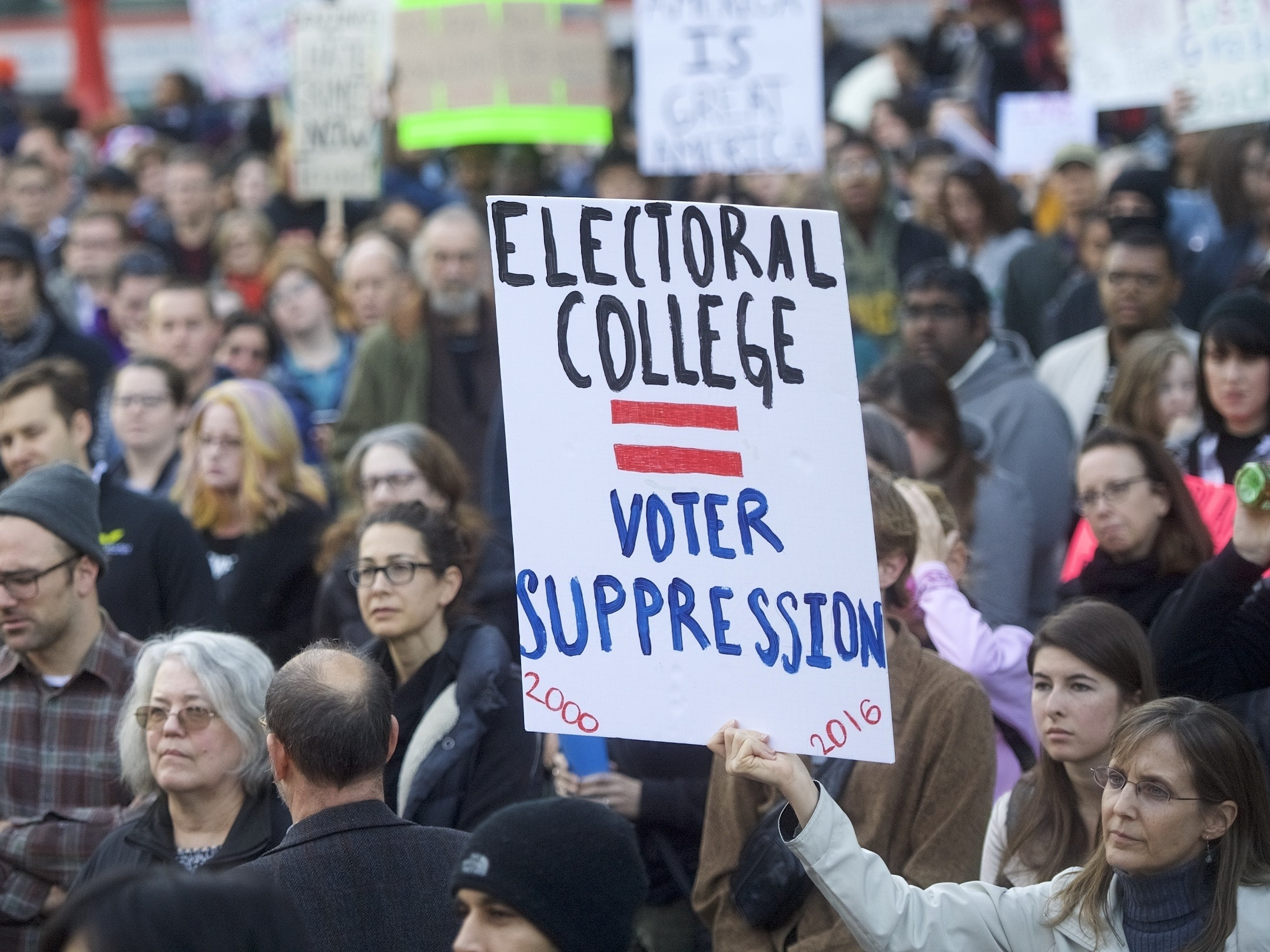 Protestors demonstrate against President-elect Donald Trump November 13, 2016 in Philadelphia, Pennsylvania.  The Republican candidate lost the popular vote by more than a million votes, but won the electoral college.