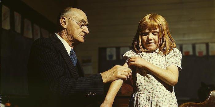 Dr. Schreiber of San Augustine giving a typhoid innoculation at a rural school, San Augustine County, Texas  (LOC)