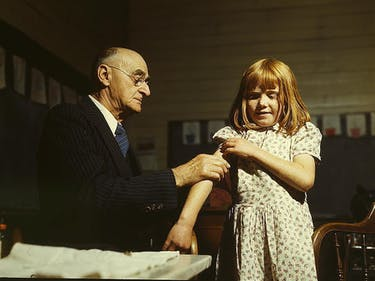 Dr. Schreiber of San Augustine giving a typhoid innoculation at a rural school, San Augustine County, Texas  (LOC)