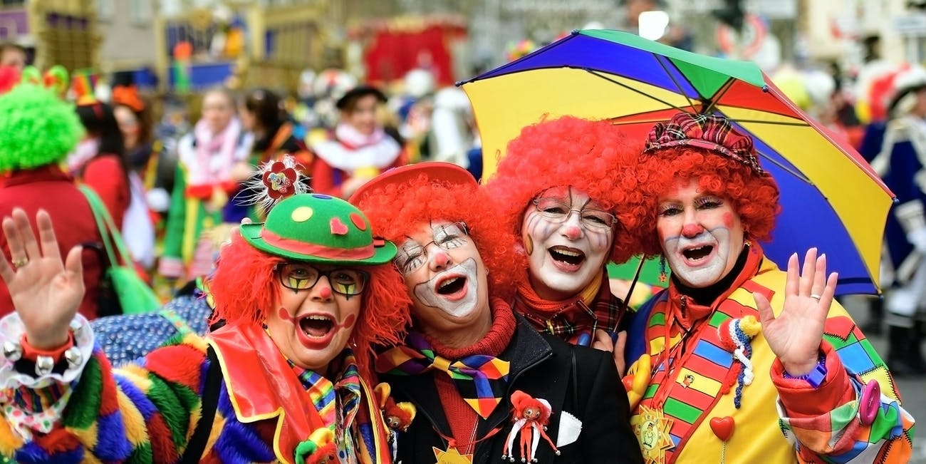 MAINZ, GERMANY - FEBRUARY 27: Women dressed as clowns celebrate the annual Rose Monday parade on February 27, 2017 in Mainz, Germany. Political satire is a traditional cornerstone of the annual parades and the ascension of Donald Trump to the U.S. presidency, the rise of the populist far-right across Europe and the upcoming national elections in Germany provided rich fodder for float designers this year. (Photo by Thomas Lohnes/Getty Images)