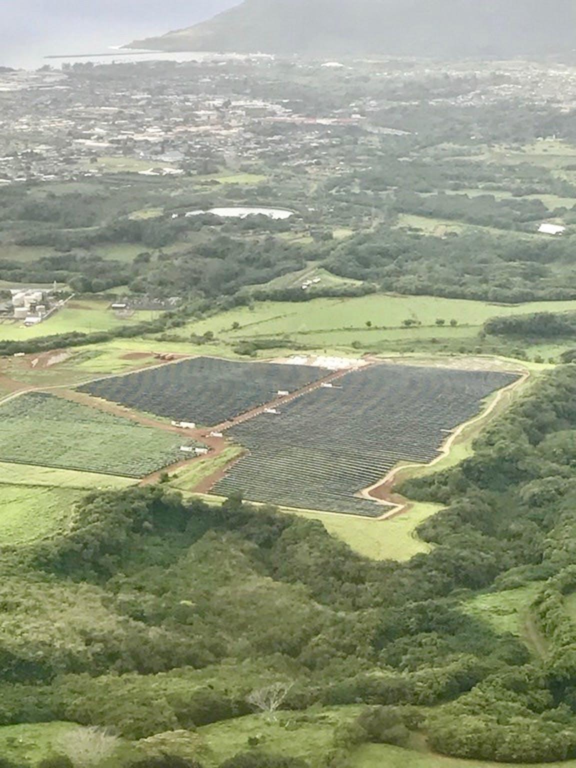 The solar farm nestled in the hills.