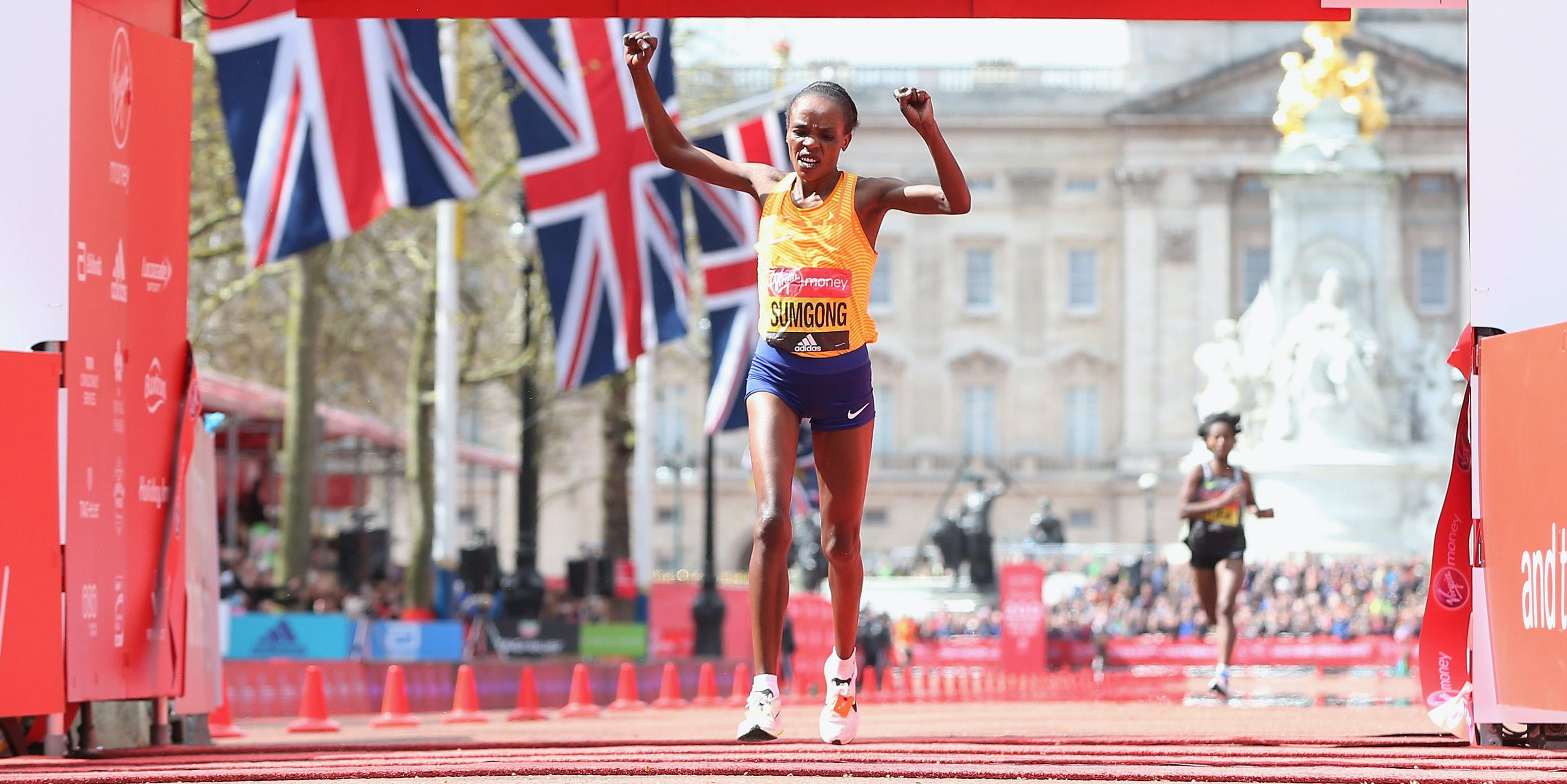 Jemima Sumgong of Kenya wins the Elite womens race during the Virgin Money Giving London Marathon at the finish on The Mall on April 24, 2016 in London, England.