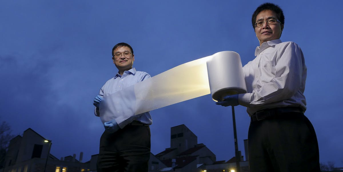 Researchers Ronggui Yang (right) and Xiaobo Yin (left) show how lightweight the material is.