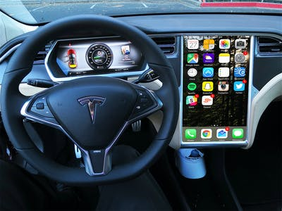 "Elon Musk Says Teslas Will ""Project"" Your Phone's Apps Onto Center Display"