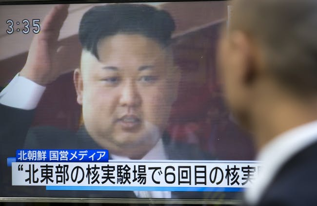 TOKYO, JAPAN - SEPTEMBER 03: A pedestrian watches a monitor showing an image of North Korean leader Kim Jong-Un in a news program reporting on North Korea's 6th nuclear test on September 3, 2017 in Tokyo, Japan. South Korea, Japan and the U.S. detected an artificial earthquake from Kilju, northern Hamgyong Province of North Korea. State news agency KCNA announced Pyongyang have successfully carried out a test of a hydrogen bomb, which could be loaded to the Intercontinental Ballistic Missile (ICBM) missile. (Photo by Tomohiro Ohsumi/Getty Images)