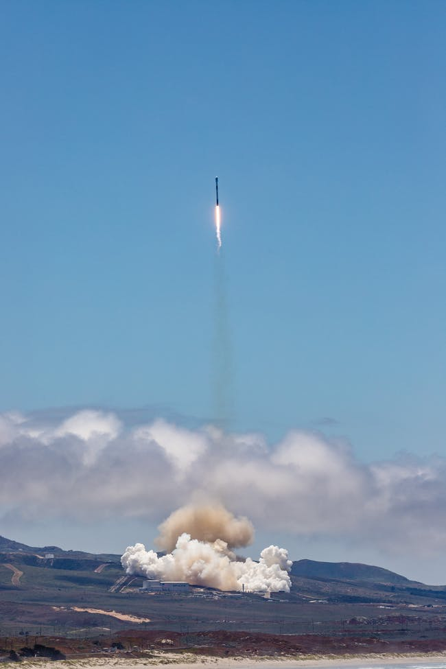 SpaceX launching from a distance.