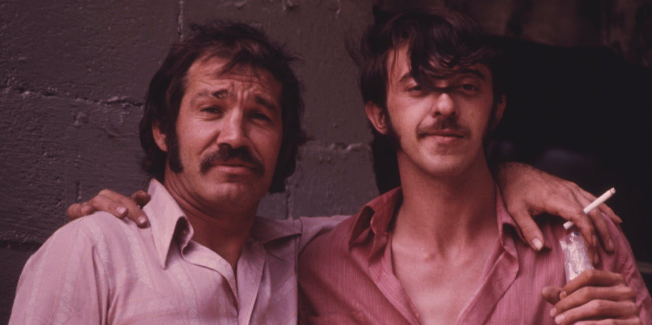 Two Miners Relaxing in a Beer Joint after Finishing Their Shift 06/1974