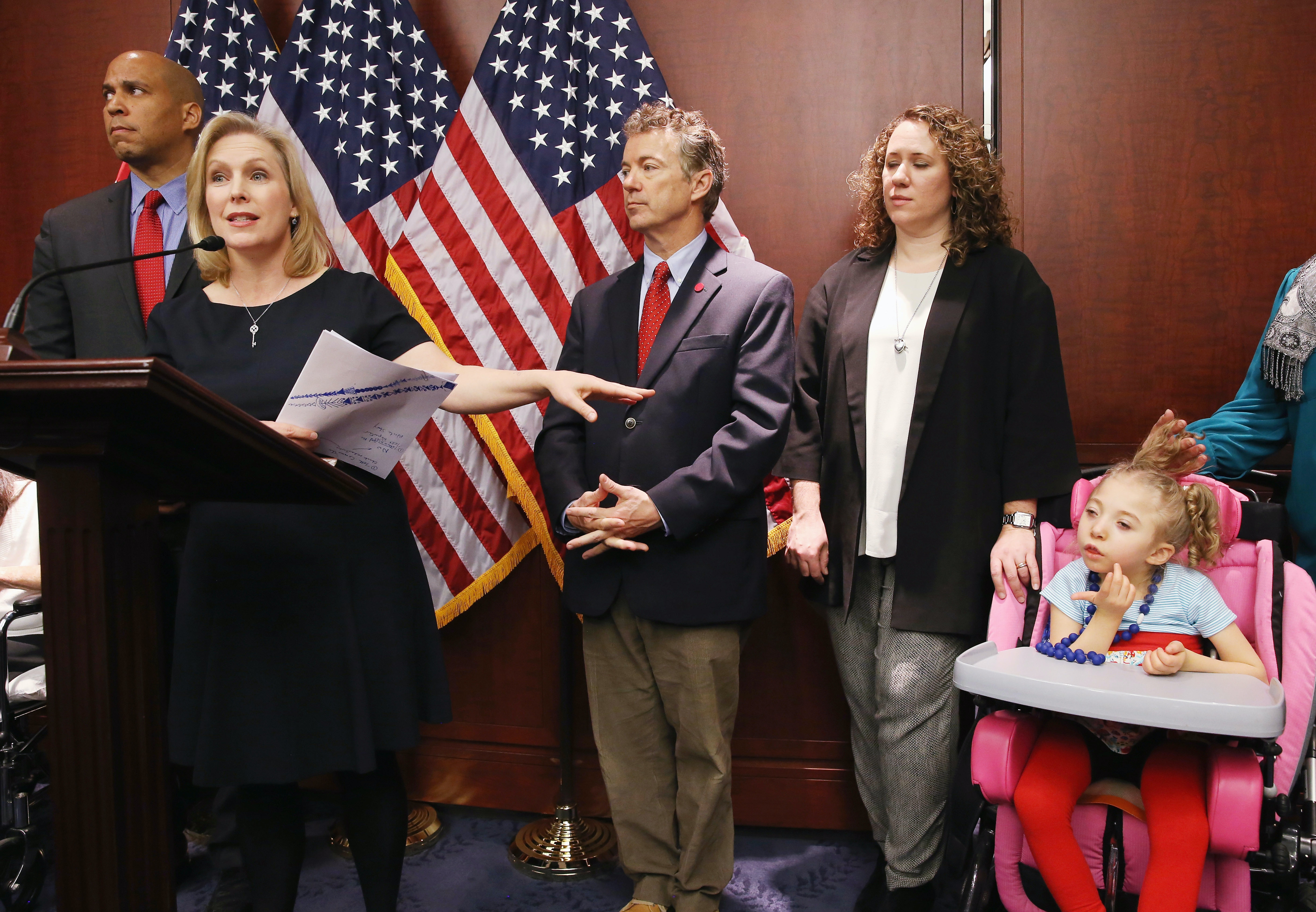U.S. Senator Kirsten Gillibrand, at podium, speaks about medical Marijuana and how it could possibly help four-year-old Morgan Hintz who suffers from a rare form of epilepsy.