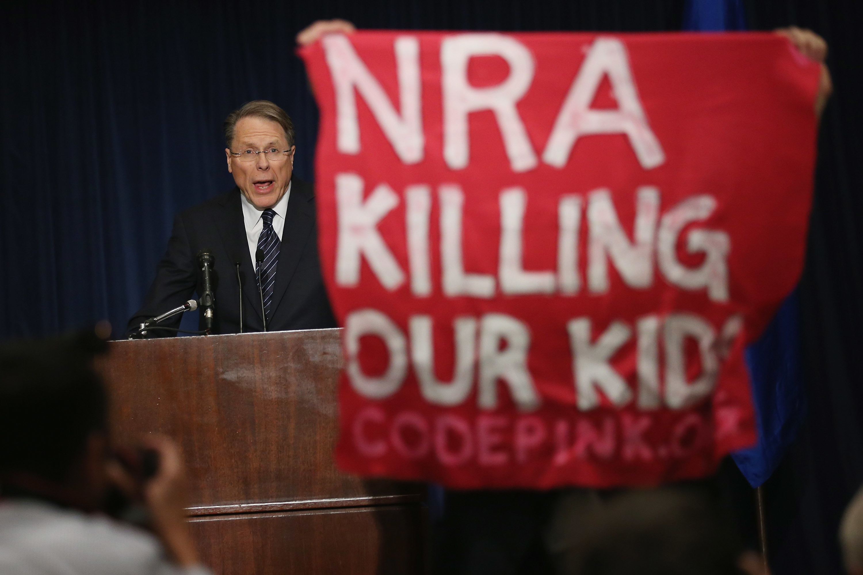 National Rifle Association president Wayne La Pierre in December 2012 is interrupted by an anti-gun activist during his first public appearance following the Sandy Hook Elementary School shooting.