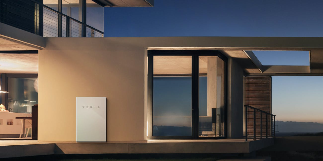Tesla Powerwall 2 on the side of a house.