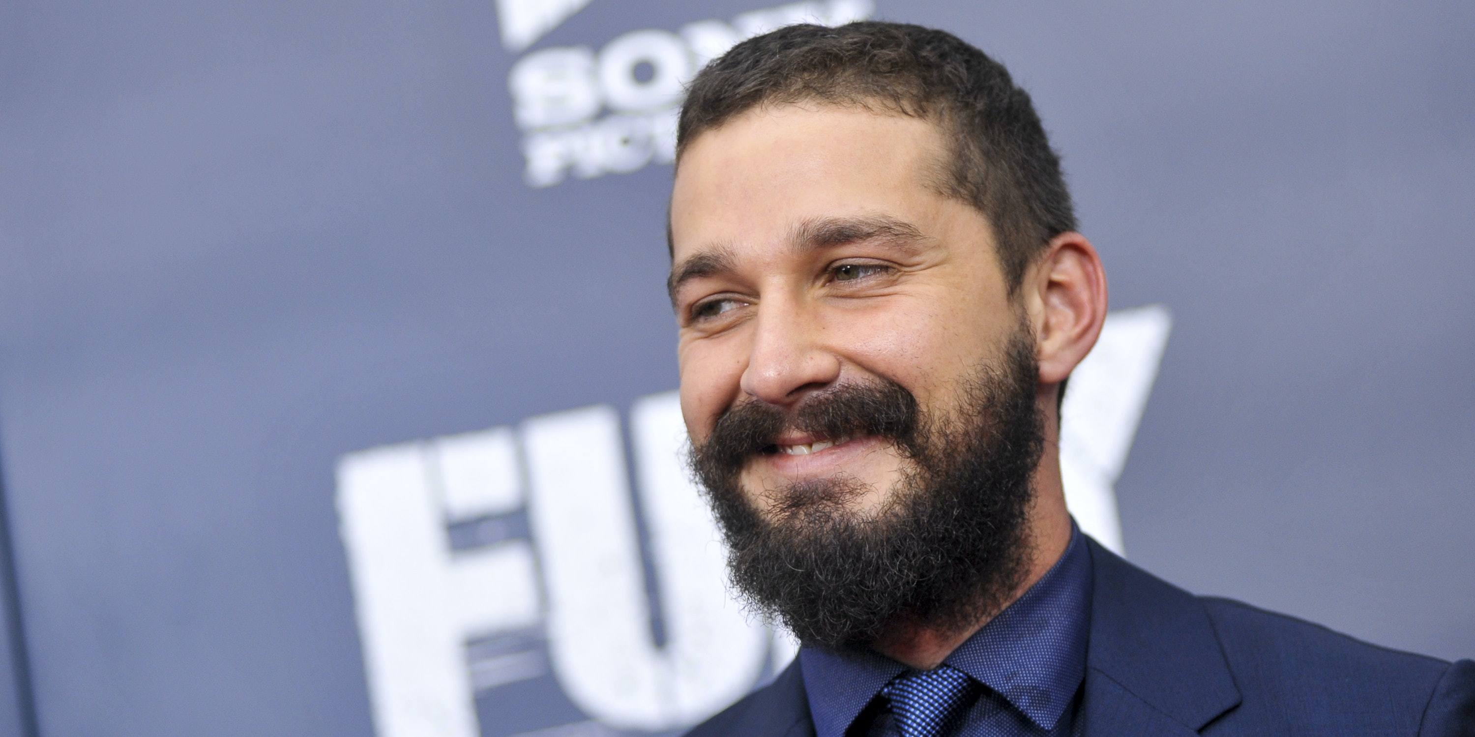 Shia LaBeouf poses for photographers on the red carpet during the 'The Fury' Washington D.C. premiere at The Newseum on October 15, 2014 in Washington, DC.