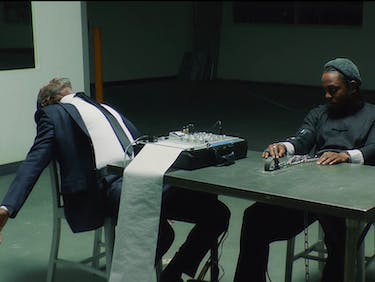 "Kendrick Lamar's ""DNA"" Video Has Don Cheadle Perfectly Lip-Syncing"