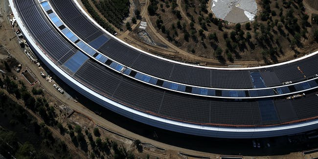 CUPERTINO, CA - APRIL 28:  An aerial view of the new Apple headquarters on April 28, 2017 in Cupertino, California. Apple's new 175-acre 'spaceship' campus dubbed 'Apple Park' is nearing completion and is set to begin moving in Apple employees. The new headquarters, designed by Lord Norman Foster and costing roughly $5 billion, will house 13,000 employees in over 2.8 million square feet of office space and will have nearly 80 acres of parking to accommodate 11,000 cars.  (Photo by Justin Sullivan/Getty Images)