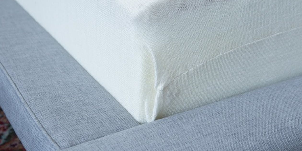 The Leesa mattress with its cloth cover removed. You can see the egg-crate–like top layer of Avena comfort foam, the (less visible) memory-foam contour layer beneath that, and the 6 inches of stiff support foam at the bottom.