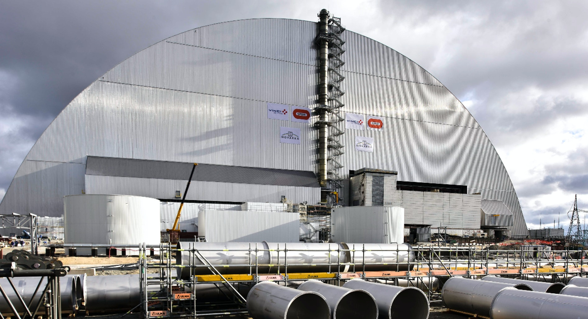 This massive sliding arch looks like an airplane hangar, but it covers a nuclear disaster.