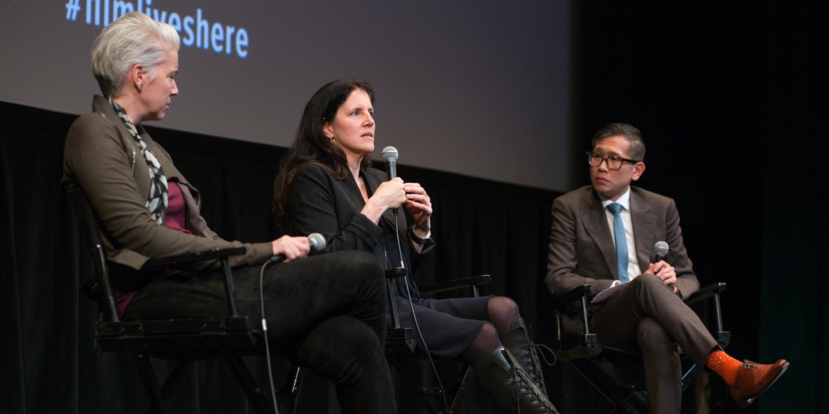 Producer Brenda Coughlin and Laura Poitras discuss 'Risk' with Dennis Lim, director of programming at the Film Society of Linclon Center, at the Walter Reade Theater in New York City on May 2.