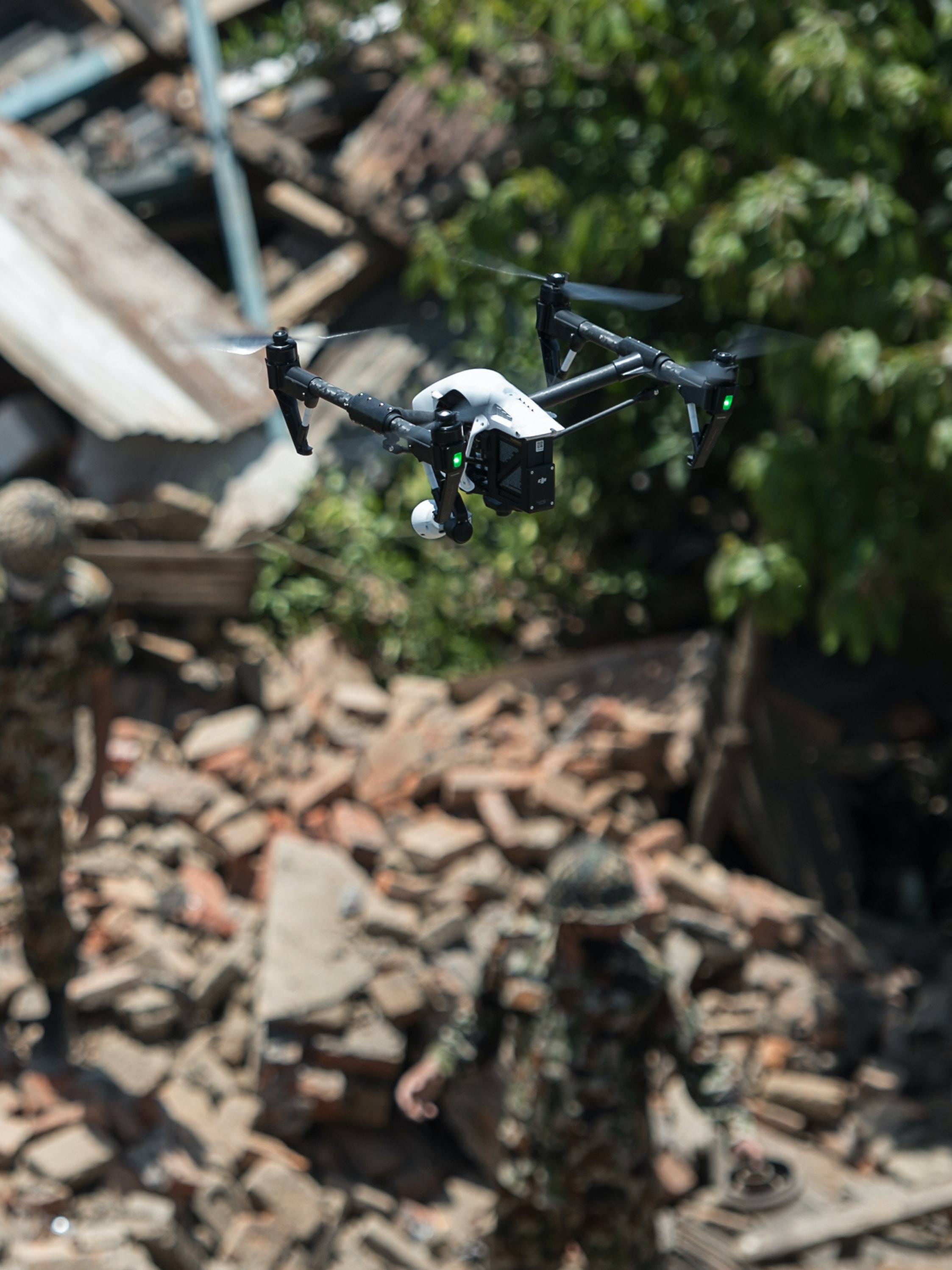 SANKHU, NEPAL - MAY 02:  A drone flies over collapsed buildings during removal operations on May 2, 2015 in Sankhu, Nepal. A major 7.8 earthquake hit Kathmandu mid-day on Saturday, and was followed by multiple aftershocks that triggered avalanches on Mt. Everest that buried mountain climbers in their base camps. Many houses, buildings and temples in the capital were destroyed during the earthquake, leaving over 6000 dead and many more trapped under the debris as emergency rescue workers attempt to clear debris and find survivors. Regular aftershocks have hampered recovery missions as locals, officials and aid workers attempt to recover bodies from the rubble.  (Photo by David Ramos/Getty Images)