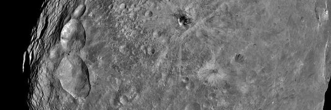 IN SPACE JULY 24:  In this handout from NASA, the giant asteroid Vesta is seen in an image taken from the NASA Dawn spacecraft about 3,200 miles above the surface July 24, 2011 in Space. The Dawn spacecraft slipped into orbit around the asteroid on July 15, and for the next year will gather pictures and information. It will then travel to the asteroid Ceres, arriving in 2015. (Photo by NASA/JPL-Caltec via Getty Images)