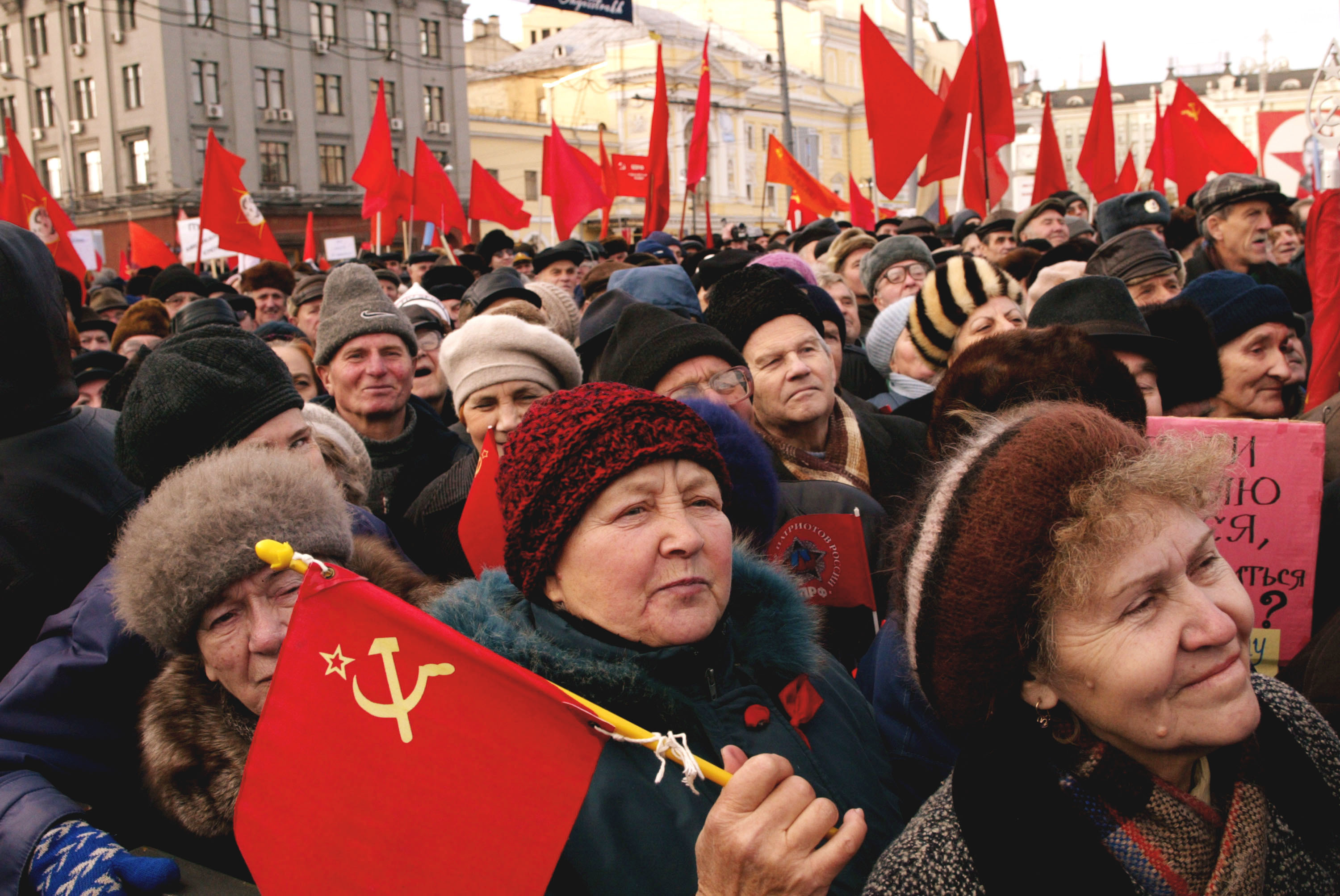 Older Communist supporters hold Soviet flags as they march to commemorate the 1917 Bolshevik revolution November 7, 2002 in Moscow, Russia.