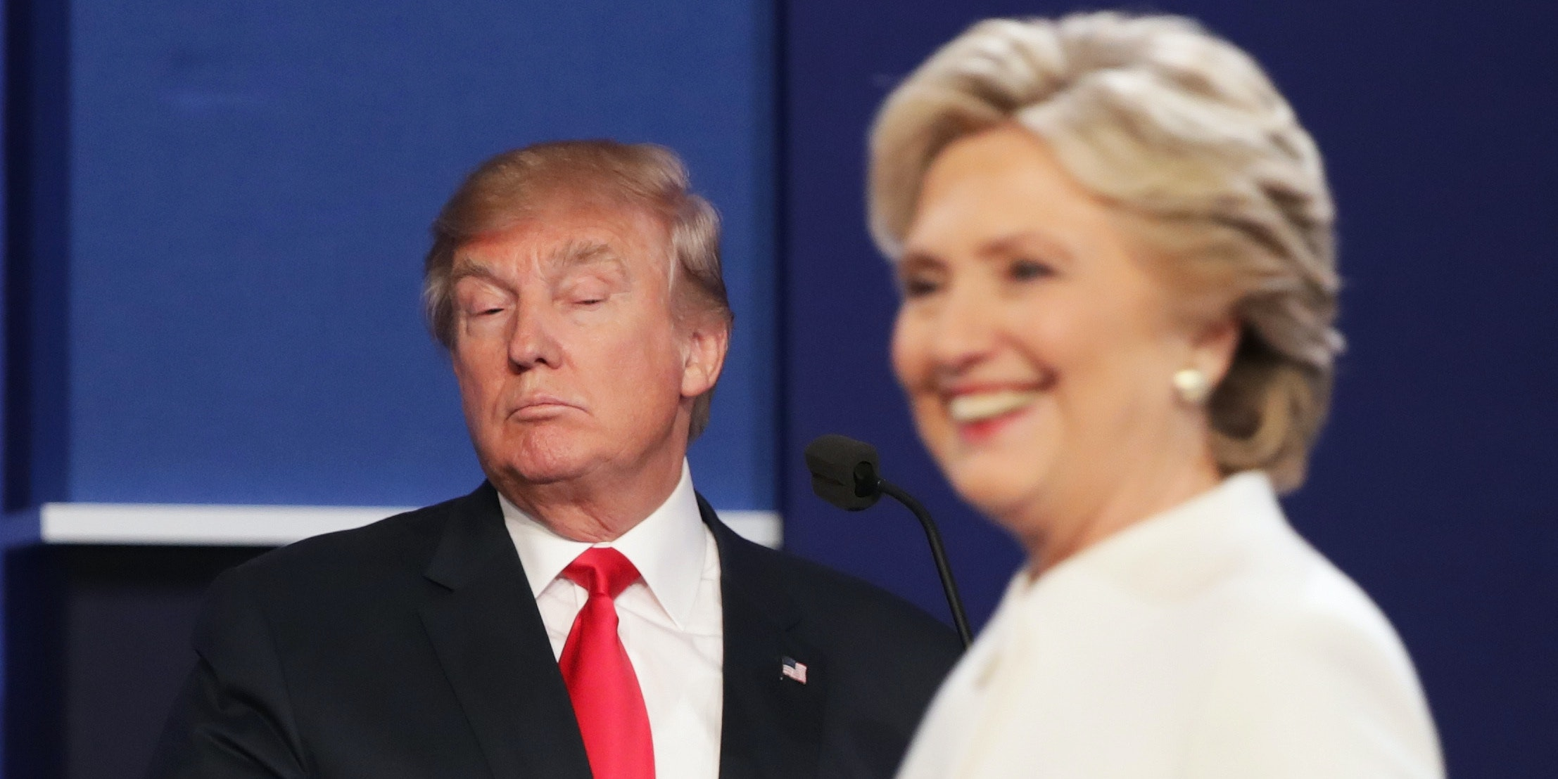 Democratic presidential nominee former Secretary of State Hillary Clinton walks off stage as Republican presidential nominee Donald Trump looks on during the third U.S. presidential debate at the Thomas & Mack Center on October 19, 2016 in Las Vegas, Nevada. Tonight is the final debate ahead of Election Day on November 8.