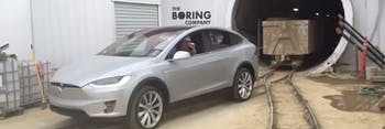 The Boring Company working with a Tesla Model X to pull out dirt.