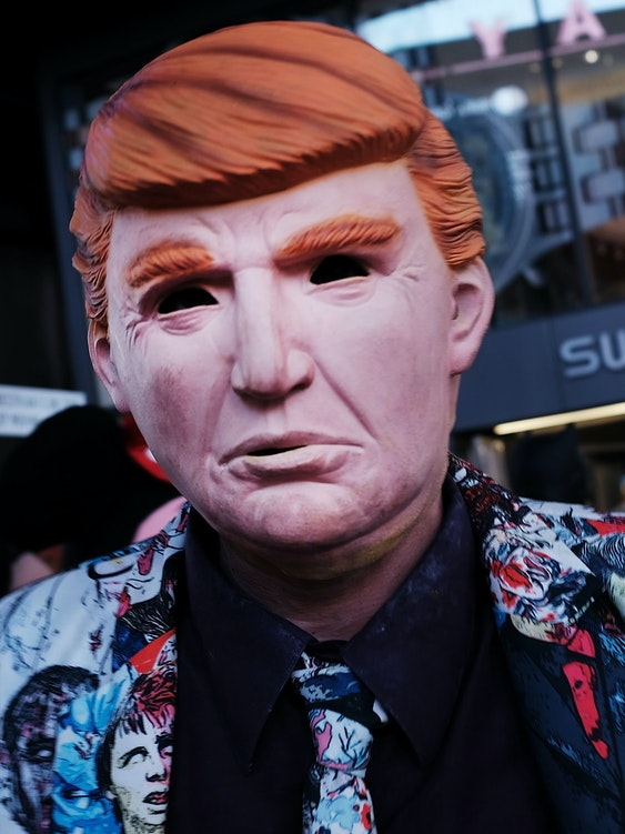 NEW YORK, NY - OCTOBER 17: A Times Square performer works in a Donald Trump mask on October 17, 2016 in New York City. As the nation prepares for the final debate between presidential candidates Donald Trump and Hillary Clinton, America has become transfixed on the issues surrounding the two historic candidates. America will go to the poles to pick the next president on November 8.  (Photo by Spencer Platt/Getty Images)