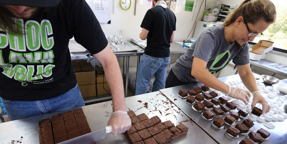 Smaller-dose pot-infused brownies are divided and packaged at The Growing Kitchen in Boulder, Co.